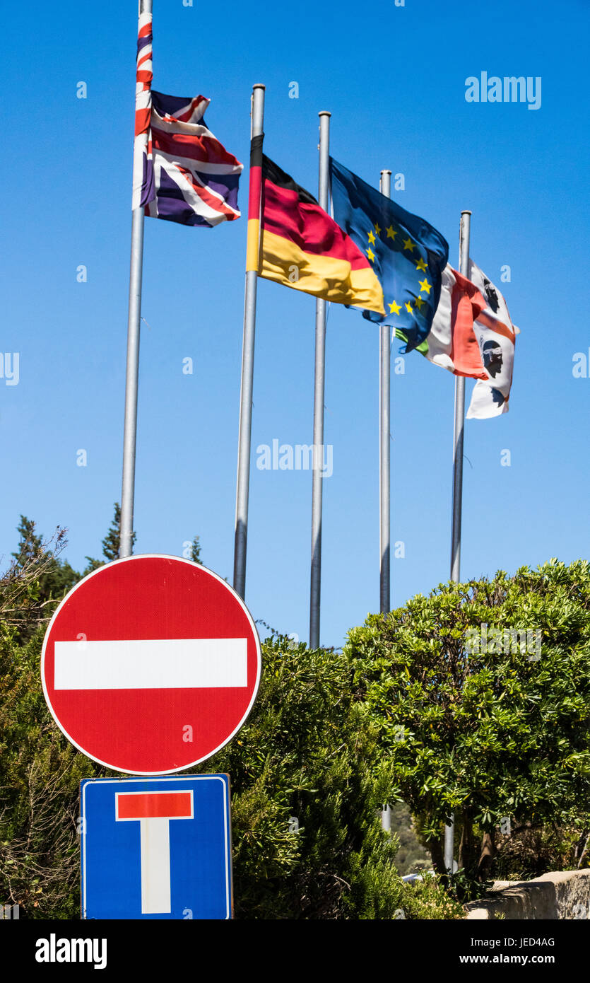 Union Jack, European Flags with 'No Entry' and 'No Through Road' Road Signs. Baia Sardinia, Sardinia, - Stock Image