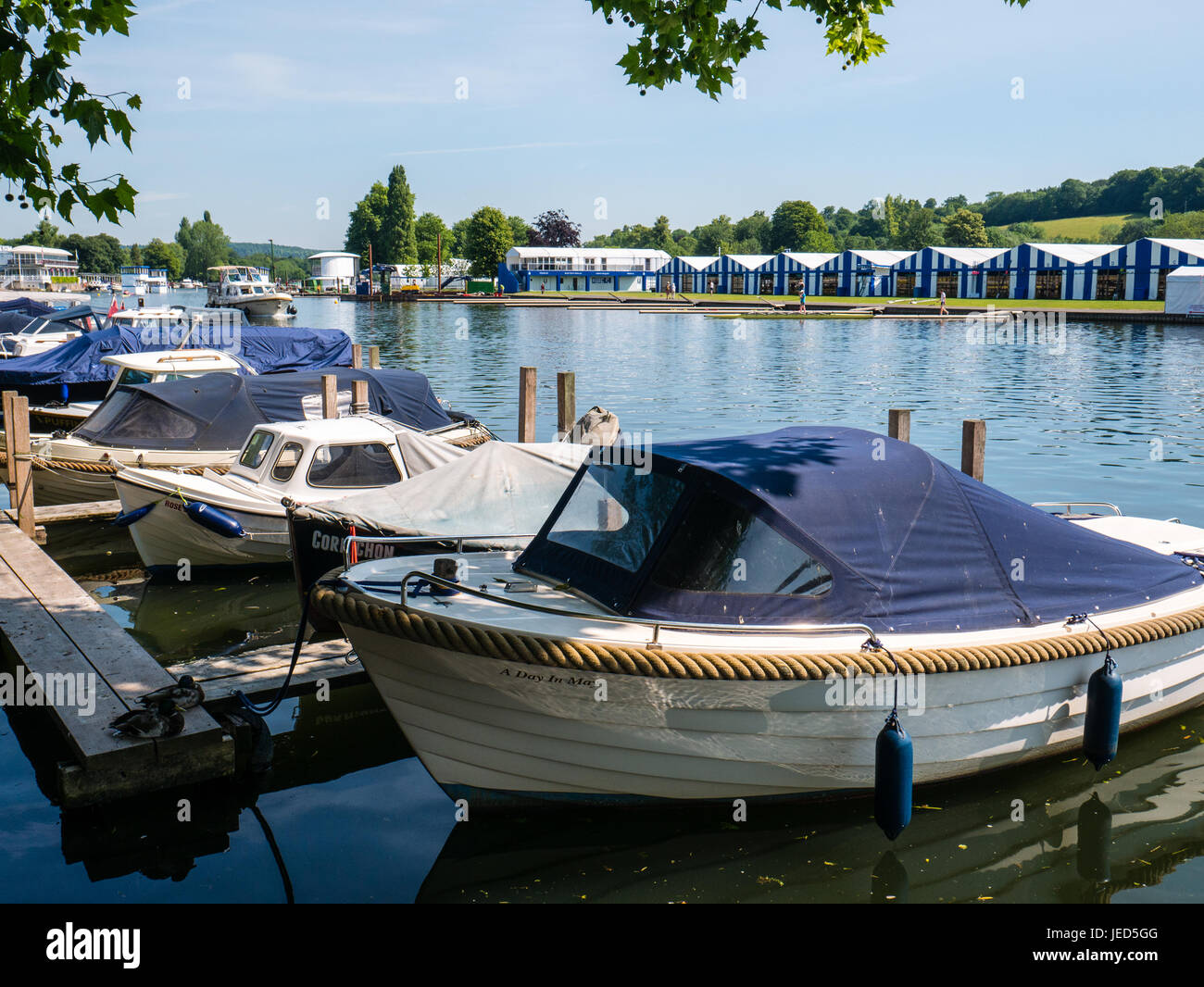 Small Boats with Rowing club in Background, Henley-on-Thames, Oxfordshire, England - Stock Image
