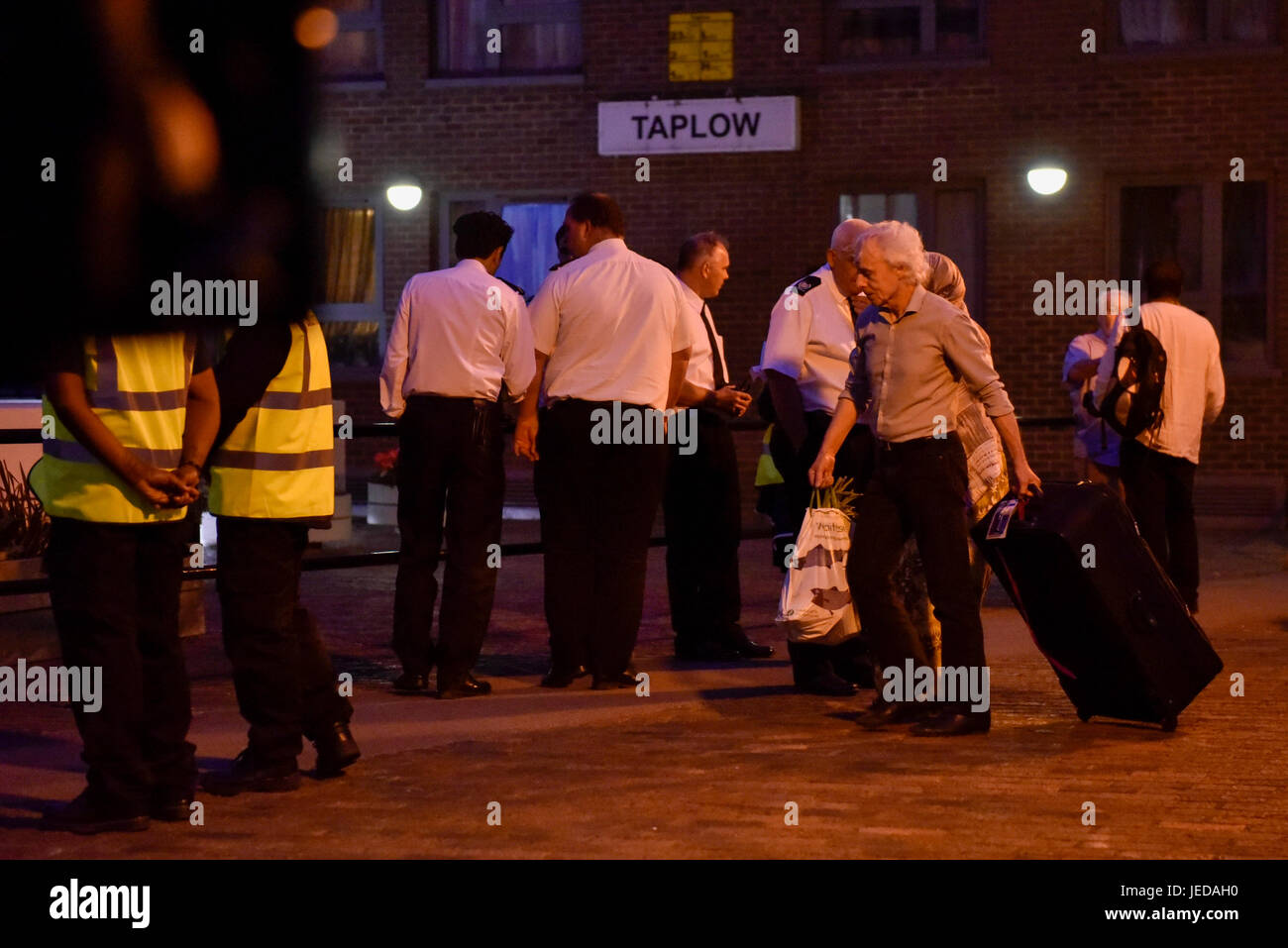 London, UK.  23 June 2017.  Residents evacuate Taplow block, one of five tower blocks in the Chalcots Estate. Residents - Stock Image