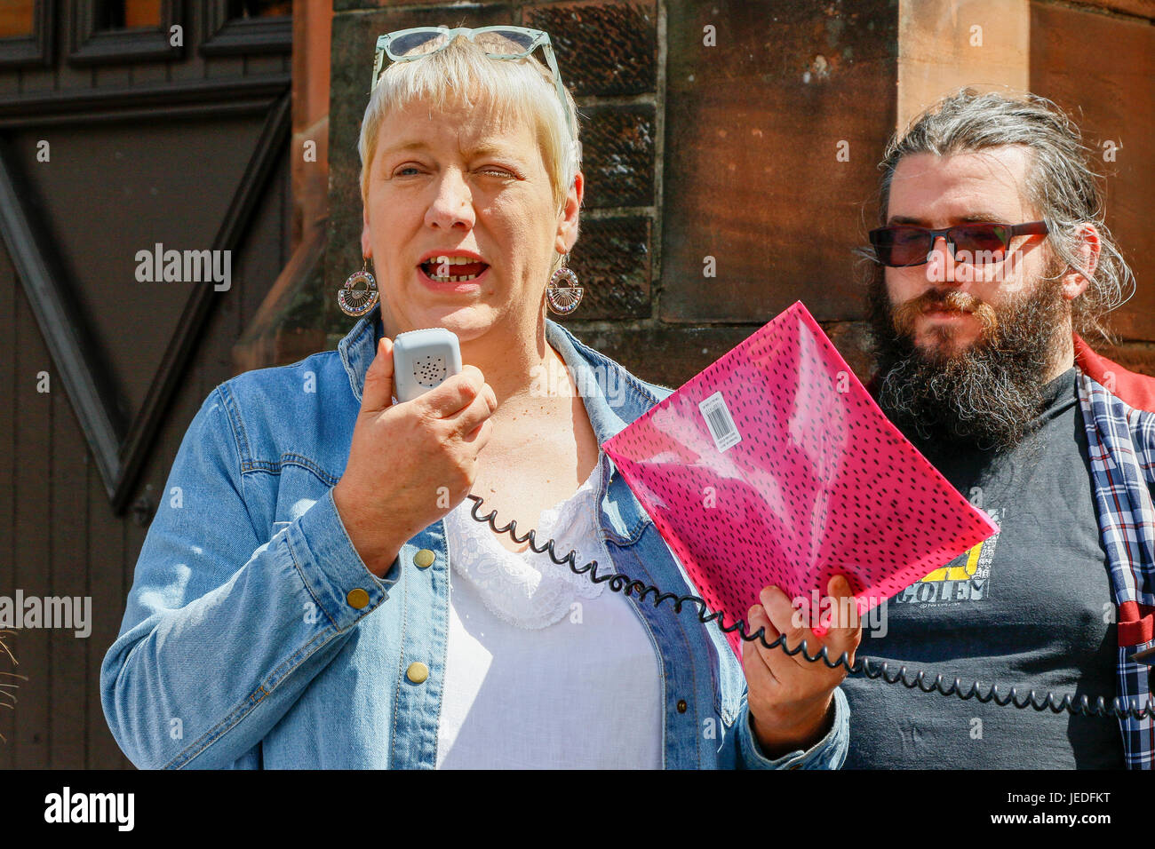 Glasgow, UK. 24th June, 2017. LIZ CROSBIE and FRANCES STOJILKOVIC from Govanhill Community Campaign lead a protest Stock Photo