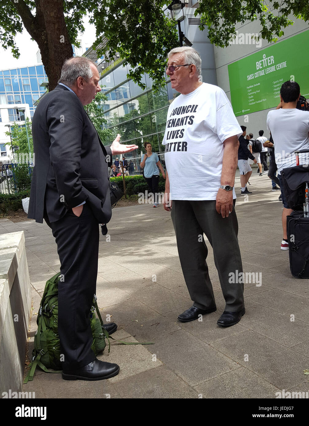 London, UK. 24th June, 2017. Outside Swiss Cottage Leisure Centre, a Fire Safety Inspector speaks with resident - Stock Image