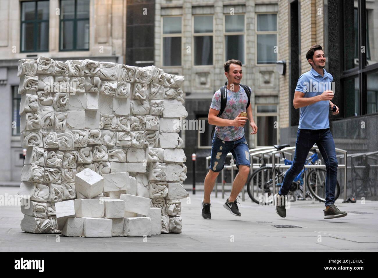 London, UK.  24 June 2017. Boys run past 'Reminiscence', 2017, by Fernando Casasempere.  The artwork is - Stock Image