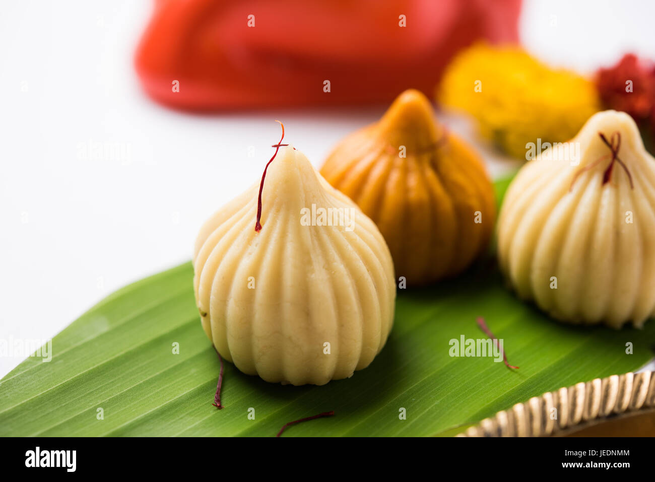 A modak is an Indian sweet dumpling popular in many parts of India. It is called modak in Marathi and Konkani as - Stock Image