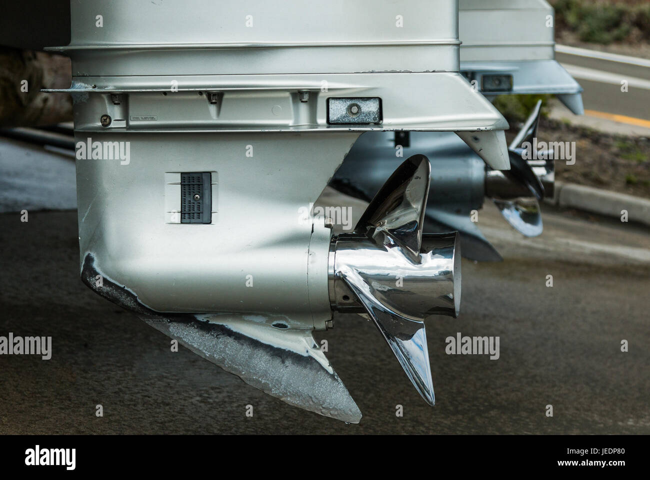 Twin propellers on outboard motors looking shiny and clean. - Stock Image