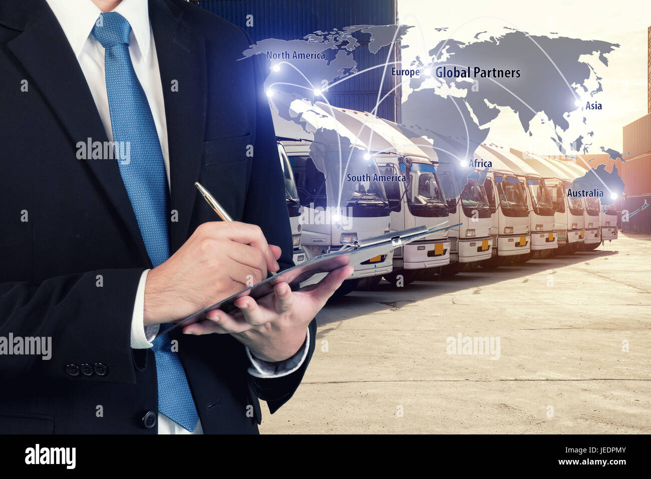 Businessman is booking with blurred cargo , transportation port and world map. Transportation logistic business - Stock Image