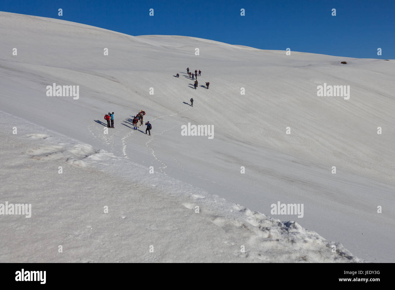 Group of trekkers hiking in Himalayas for Sarpass Trek in Kasol, Himachal Pradesh, India - Stock Image