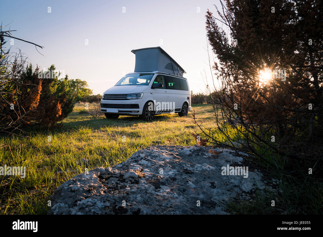 Camper with roof tent in the nature - Stock Image