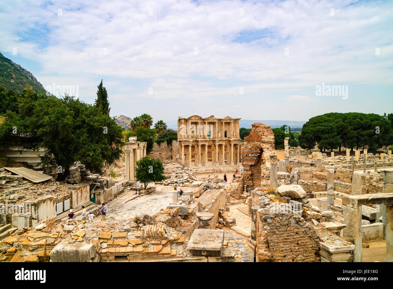 Ancient Roman Archaeological site with facade of the Library of Celsus in Ephesus, Anatolia is a popular tourist - Stock Image