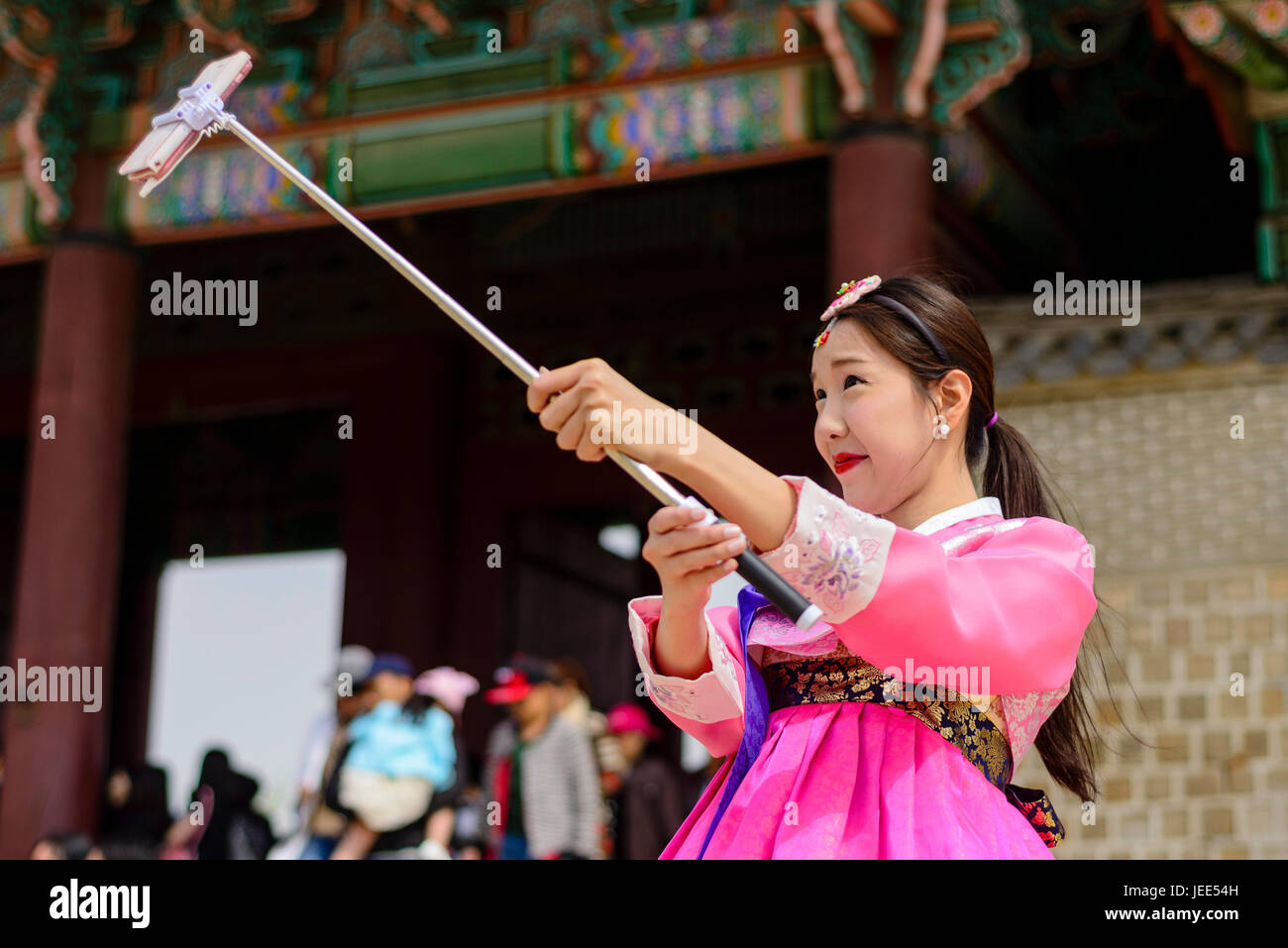 Wearing traditional hanbok around Seoul Royal Palaces - Stock Image