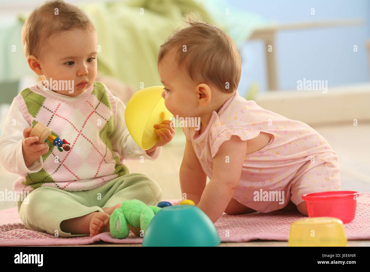 two babies, game group, social behaviour, toys, share, try out, - Stock Image