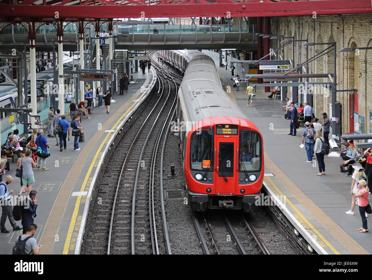 High level view of London Underground platforms 1 & 2 at Farringdon Station. Shows a new Circle Line train arriving - Stock Image