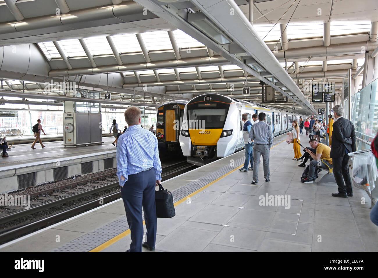 A new generation Siemens Series 700 Thameslink train arrives at Blackfriars Station, London, UK, a key station on - Stock Image