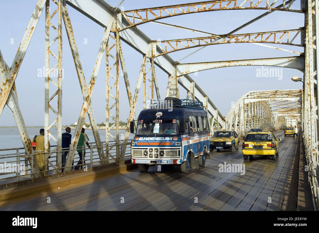Traffic, taxis, bus, pedestrian, Pont Faidherbe, river, Saint-Louis, Senegal, - Stock Image