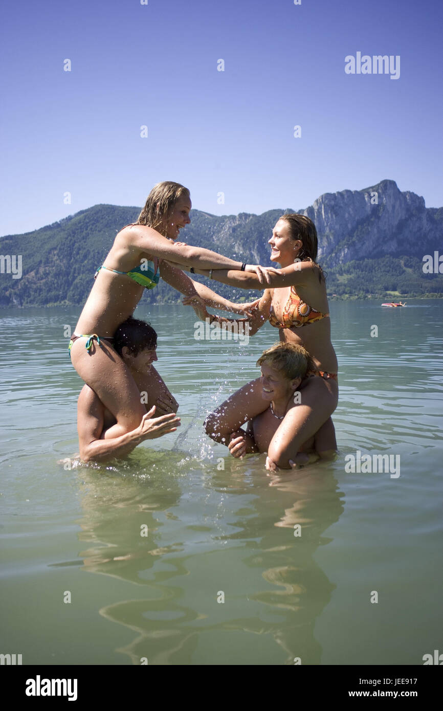 Lake, water, teenager's couples, game, 'cockfighting', at the side, people, youth, teenager, young persons, - Stock Image