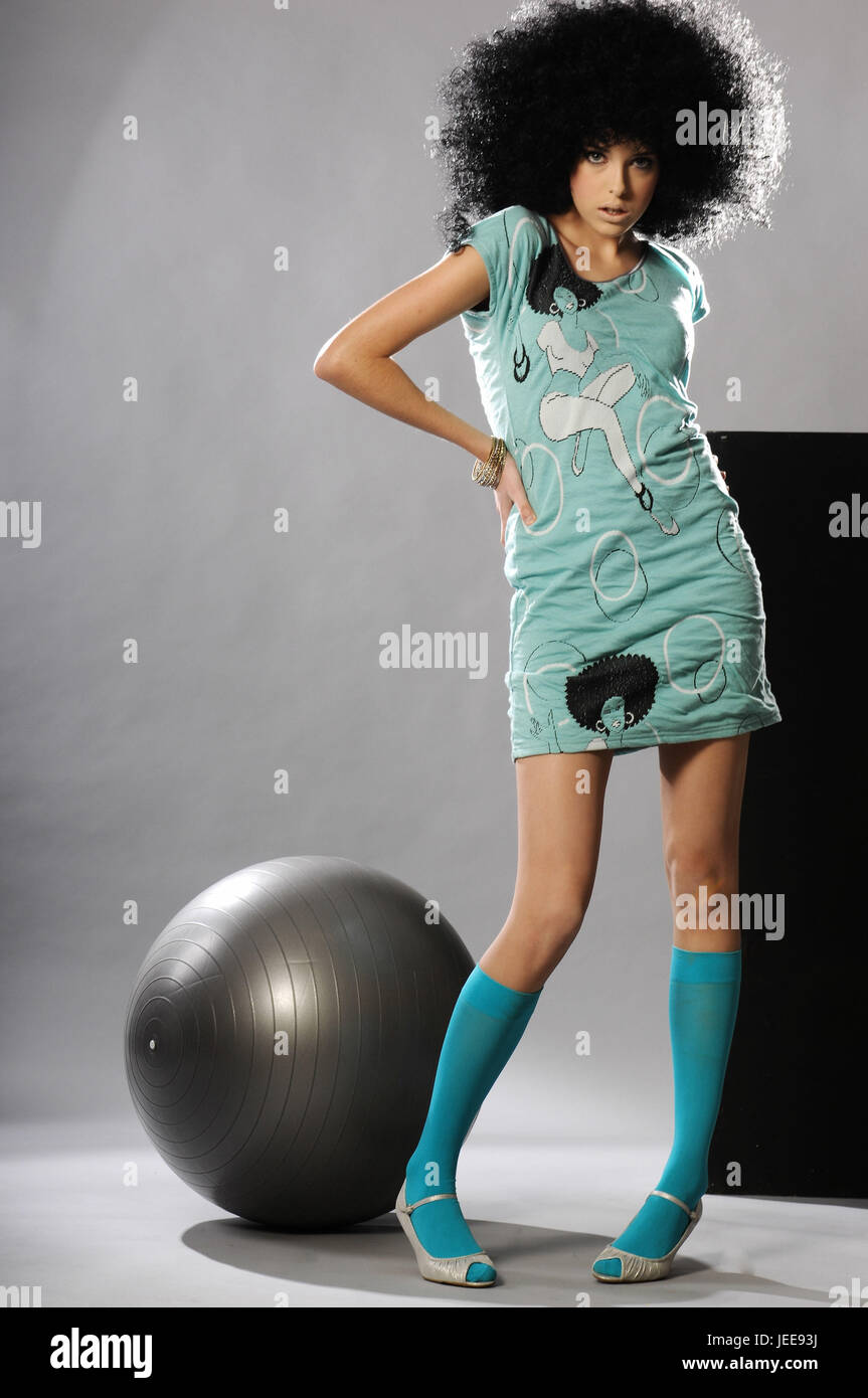 Girls, fashion, dress, wig, pose, gymnastics ball, - Stock Image