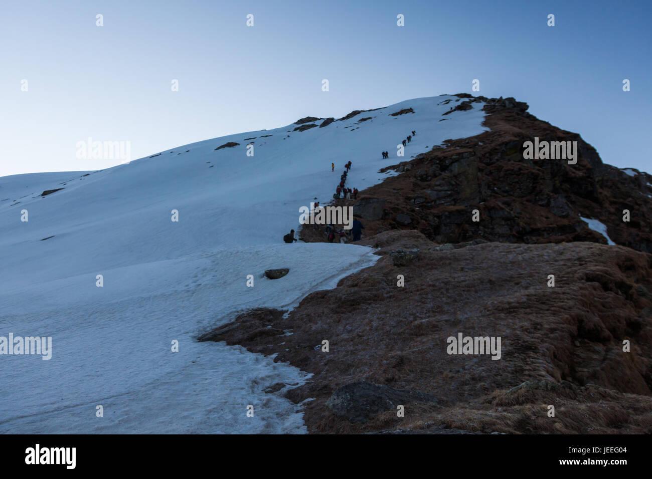 Group of trekkers hiking in Himalayas for Sarpass Trek in Kasol, Himachal Pradesh, India - Stock Image