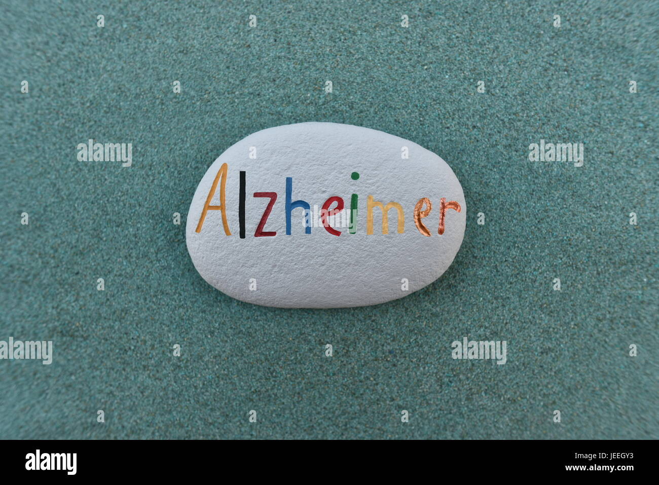 Alzheimer disease name painted on a stone - Stock Image