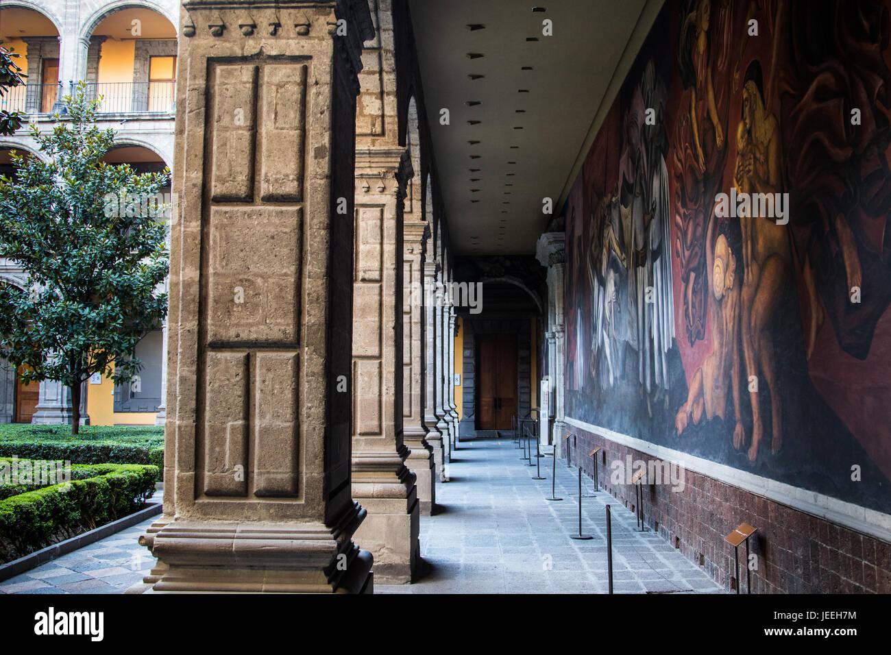 Murals in a courtyard inside Antiguo Colegio de San Ildefonso, Mexico City, Mexico - Stock Image