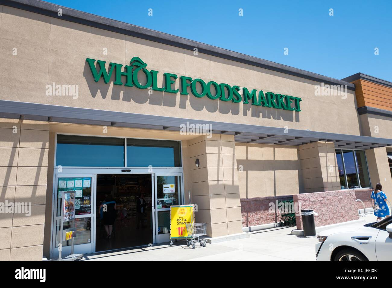 Logo and signage at the Whole Foods Market grocery store in Dublin, California, June 16, 2017. Stock Photo