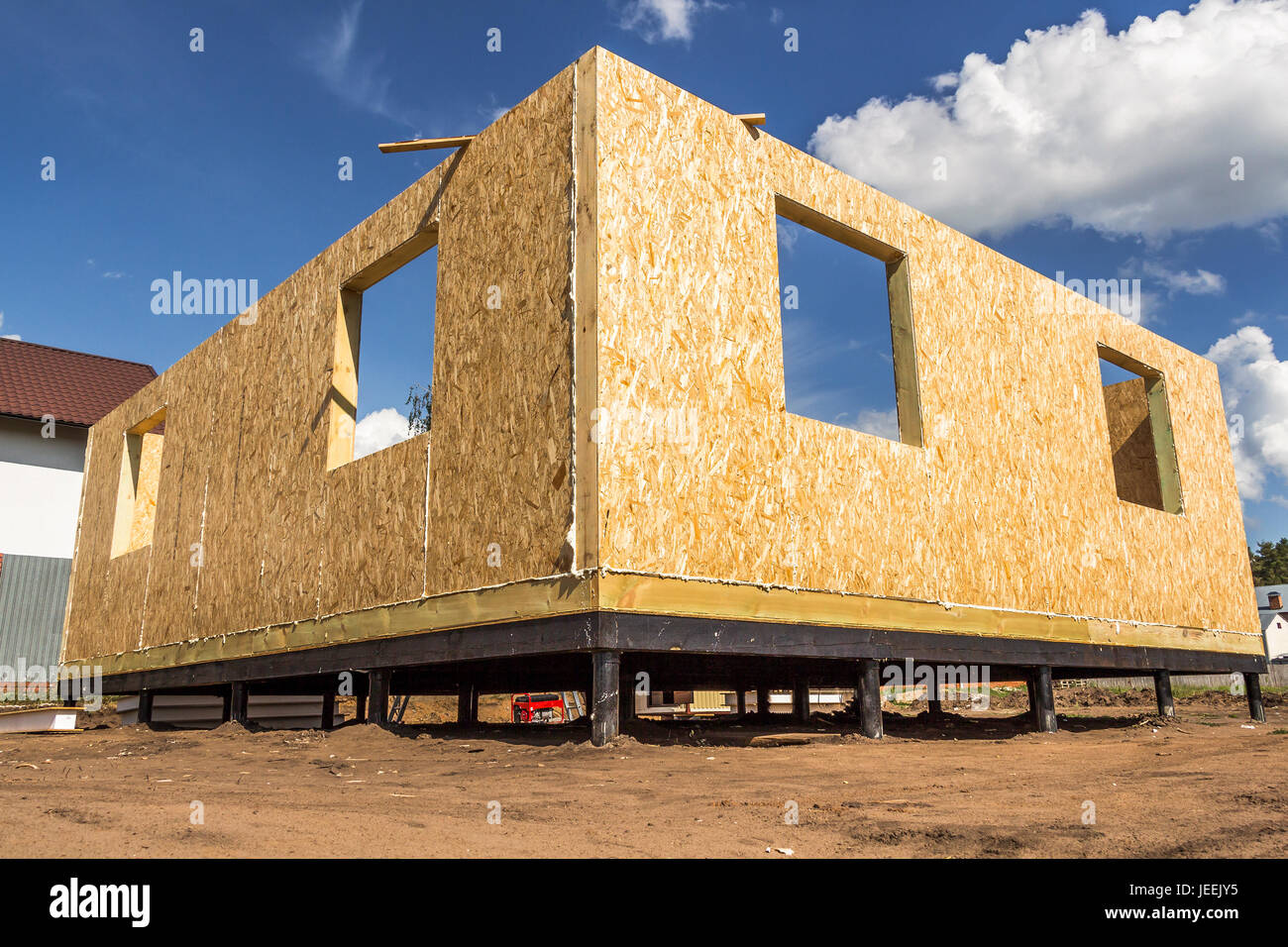 Assembling a small house of SIP panels - Stock Image