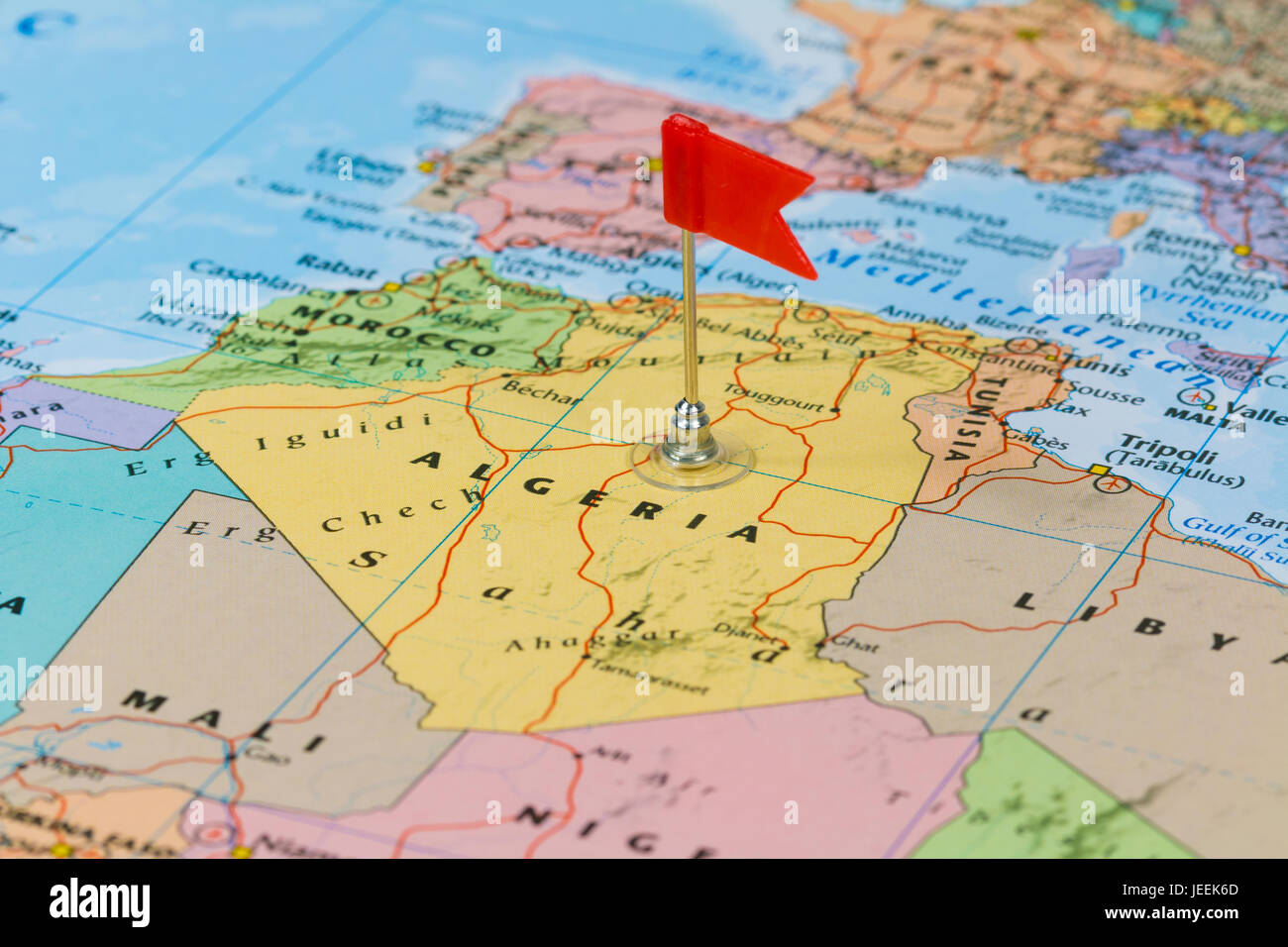Photo of Algiers marked by red flag in holder. Country on African continent. - Stock Image
