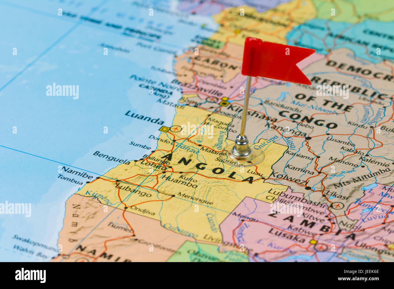 Photo of Angola marked by red flag in holder. Country on African continent. - Stock Image