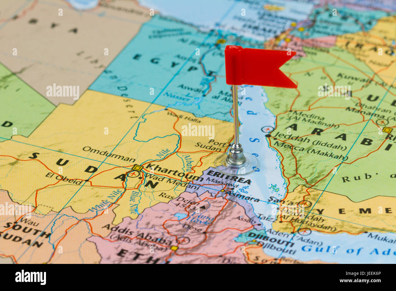 Photo of Eritrea marked by red flag in holder. Country on African continent. Stock Photo