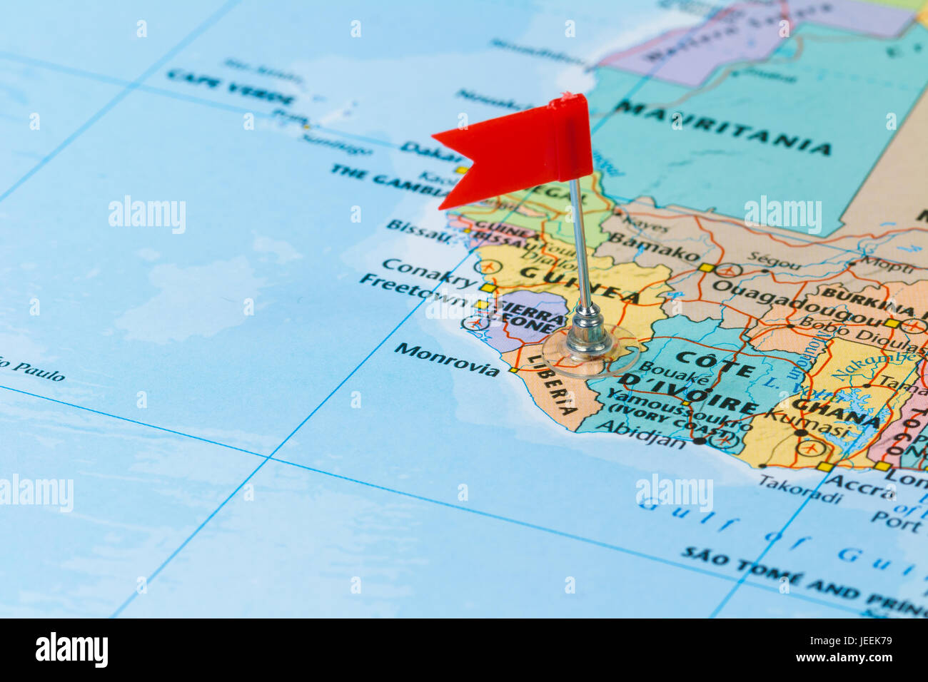 Photo of Liberia marked by red flag in holder. Country on African continent. - Stock Image