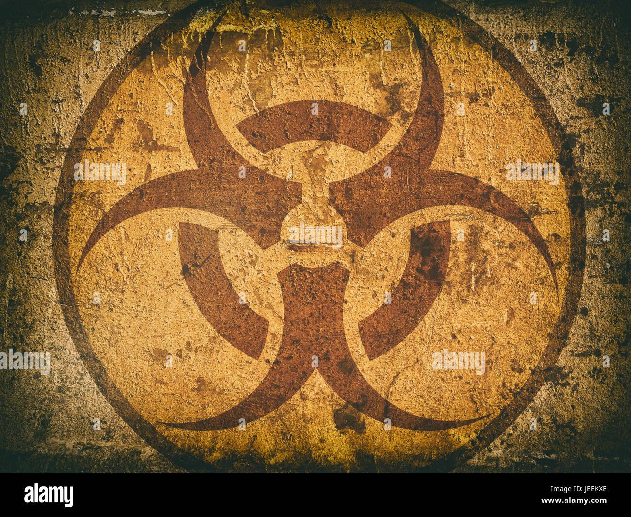 bio hazard symbol on a cracked stone wall. Grunge background Stock Photo