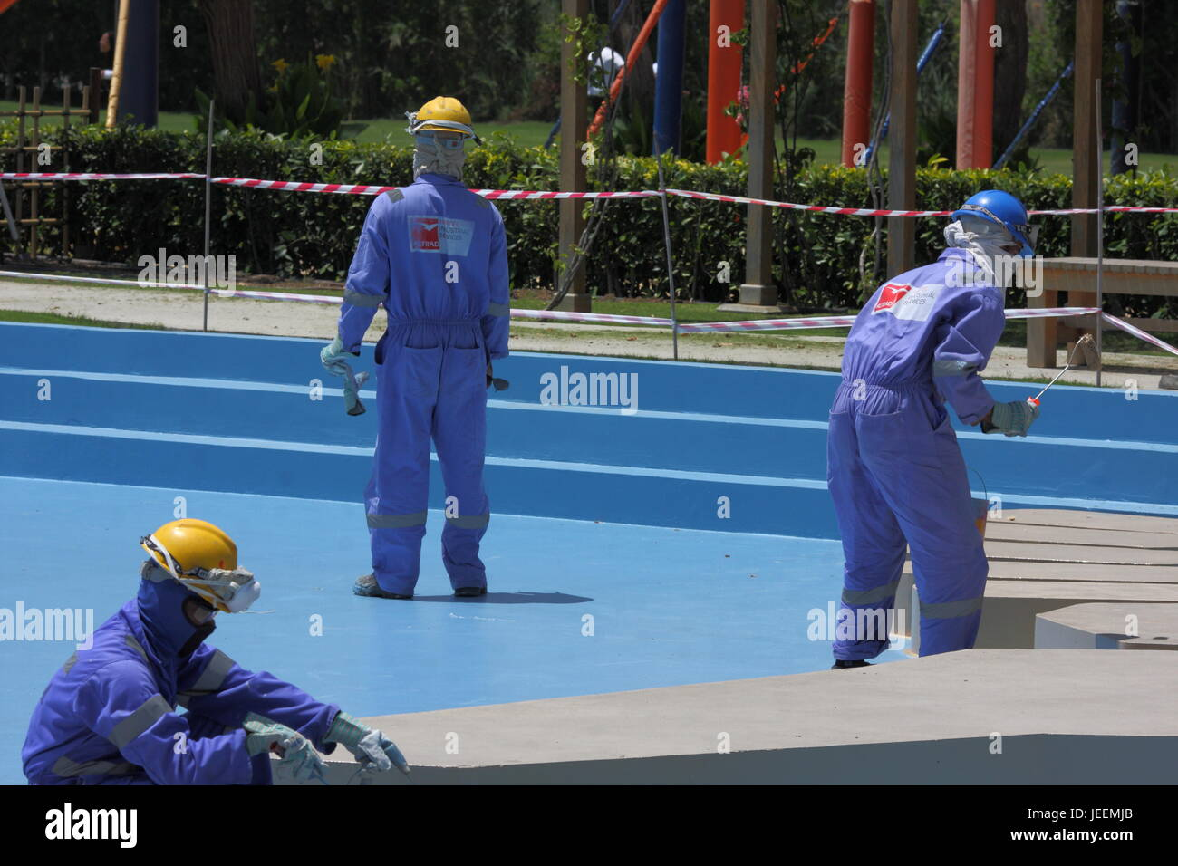 Indian migrant workers in hard hats and boiler suits, Al Areen Wildlife Park, Kingdom of Bahrain Stock Photo