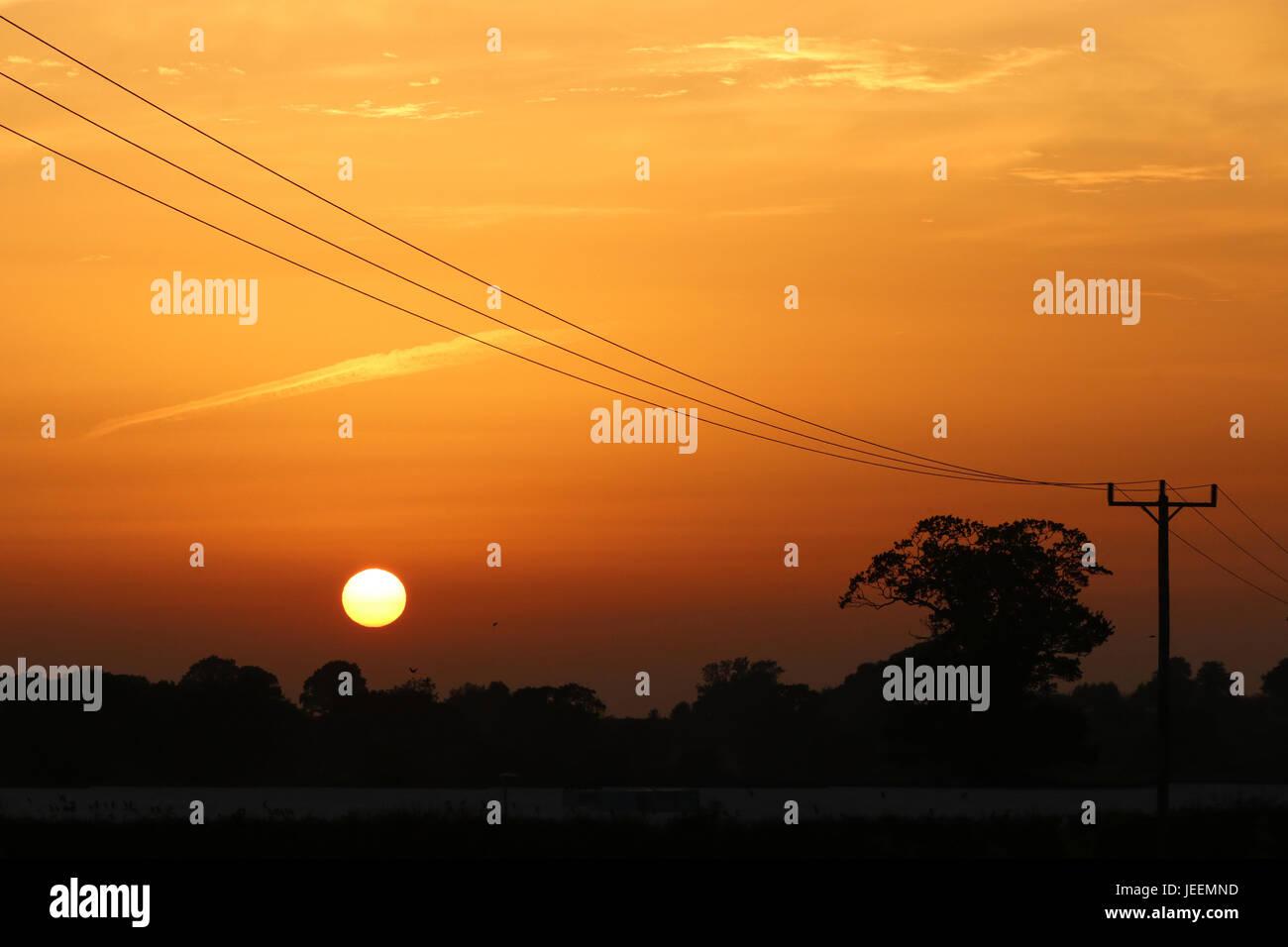 Clear orange sunset in Dorset - Stock Image