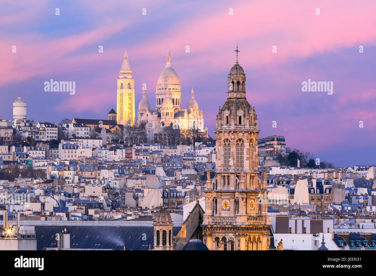 Sacre-Coeur Basilica at sunset in Paris, France - Stock Image