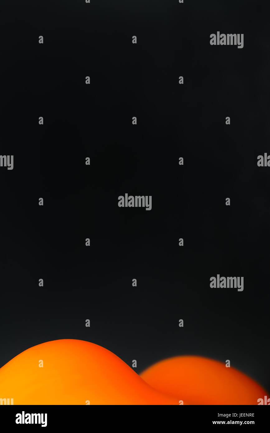 abstract orange curve on black background - Stock Image