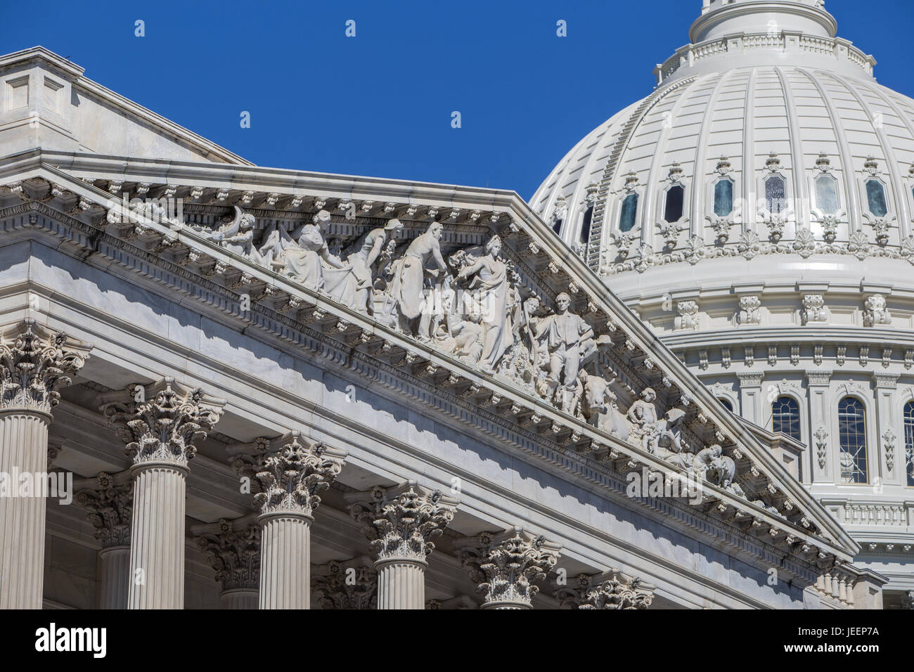 The Apotheosis of Democracy Pediment over the entrance to the south wing (House wing) of the U.S. Capitol Building - Stock Image