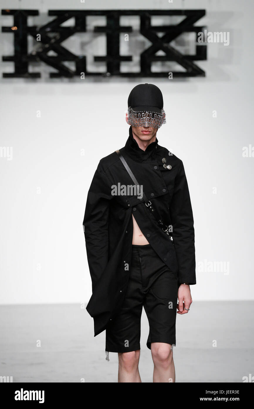 KTZ SS18 catwalk at Strand 180 during London Fashion Week Mens with a male models taking the stage  and producing - Stock Image