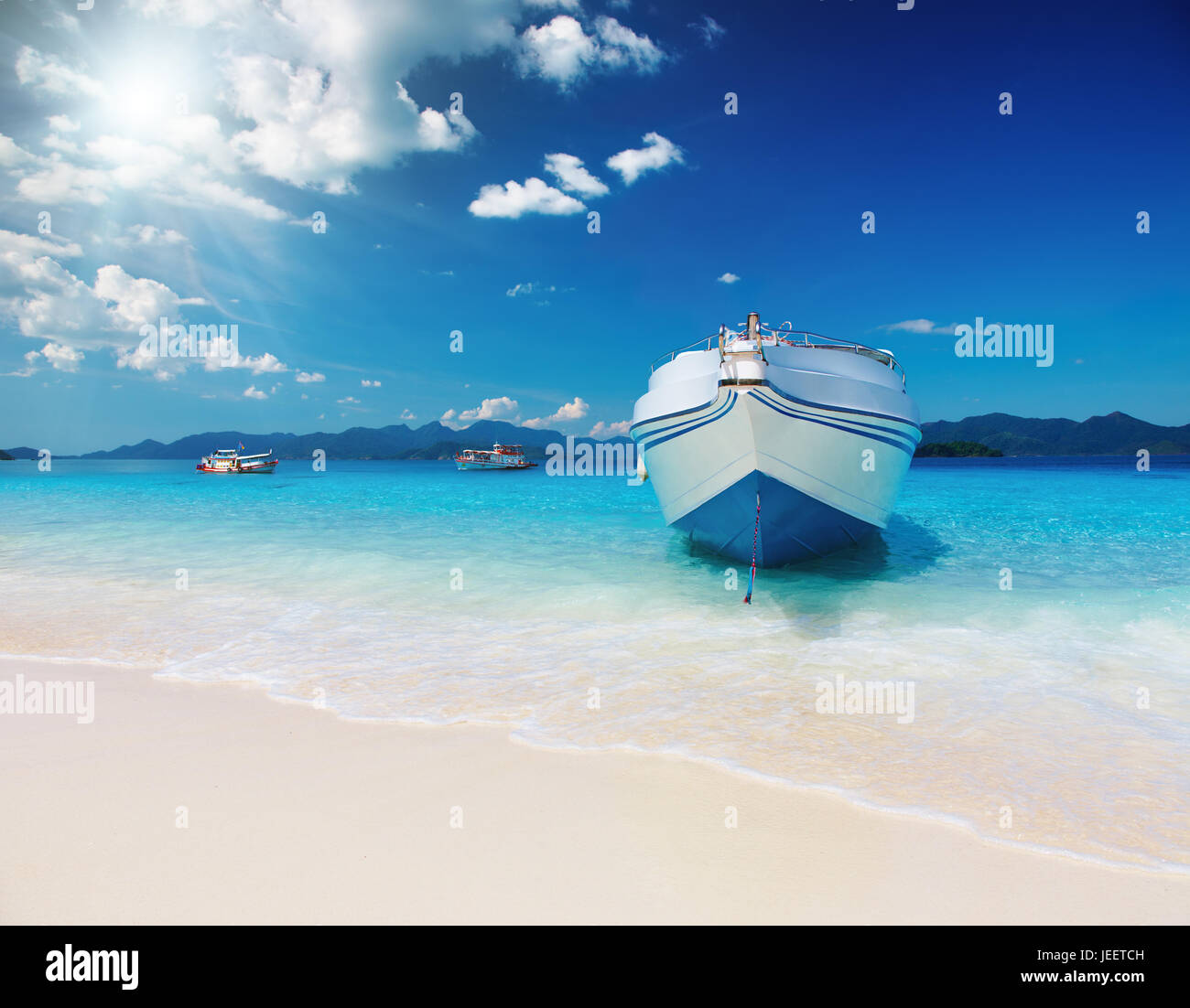 Tropical beach with white sand and azure sea - Stock Image
