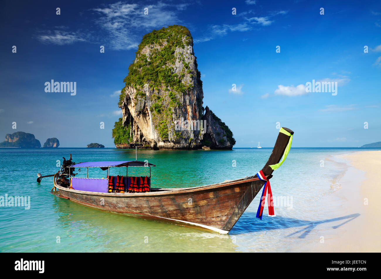 Tropical beach, longtail boat, Andaman Sea, Thailand - Stock Image