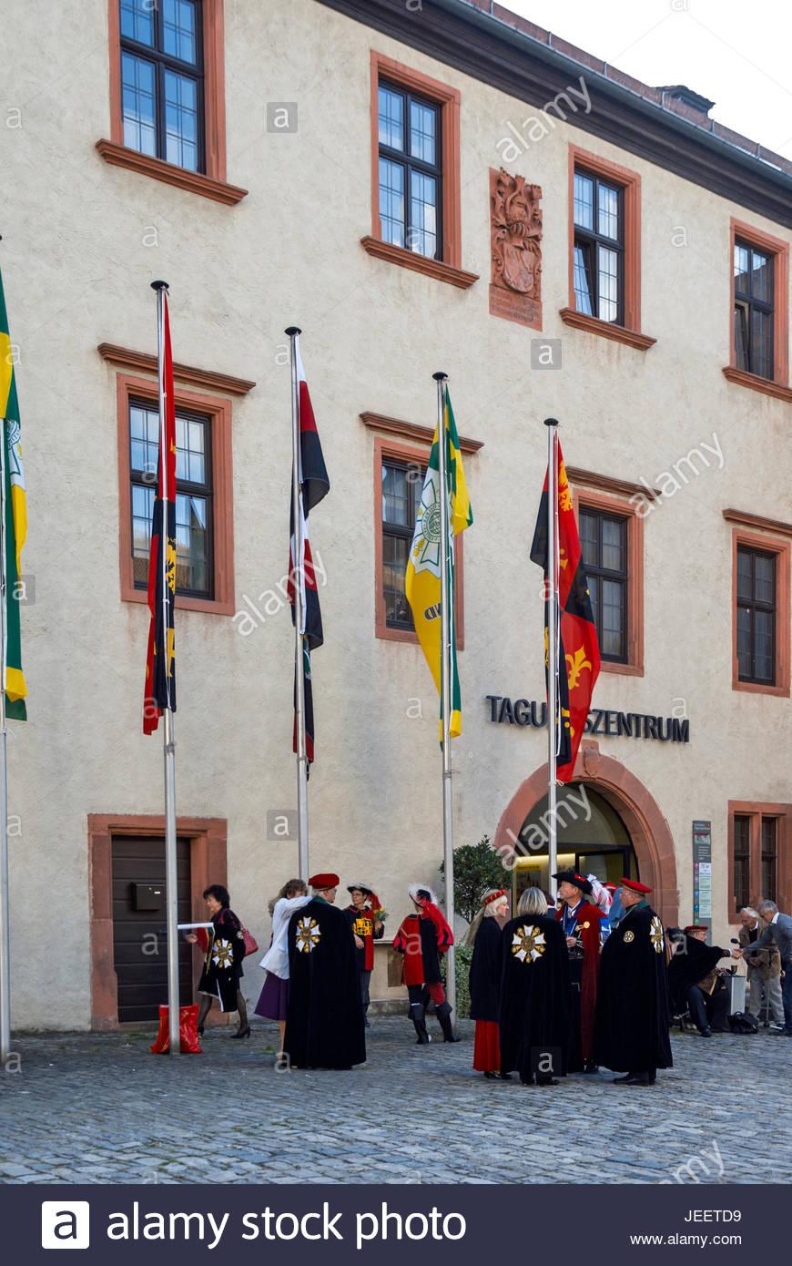 A group of Bavarians in regional costume gather at das Burkardushaus, Tagungszentrum am Dom, in Würzburg, Germany. - Stock Image