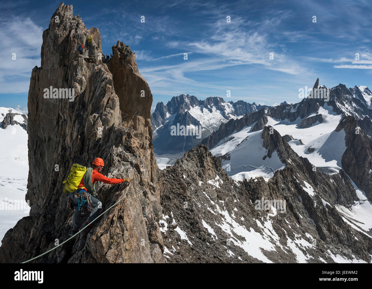 A climber on the traverse of the Aiguille d'Entrees in the Mont Blanc massif Stock Photo