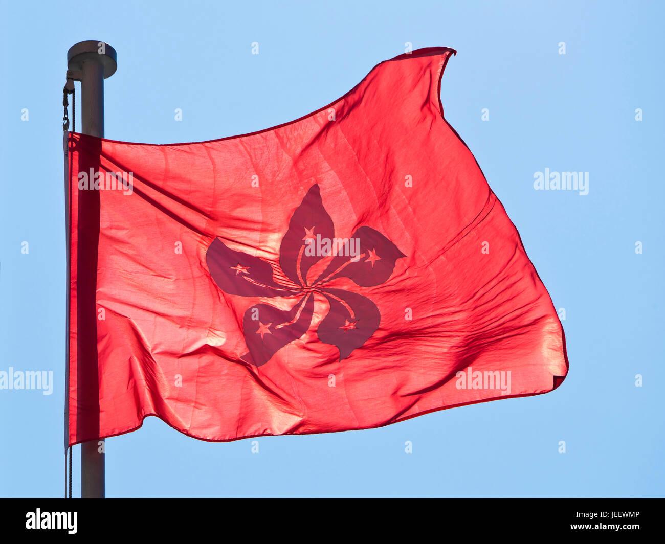 Horizontal close up view of the new national flag of Hong Kong, China. - Stock Image