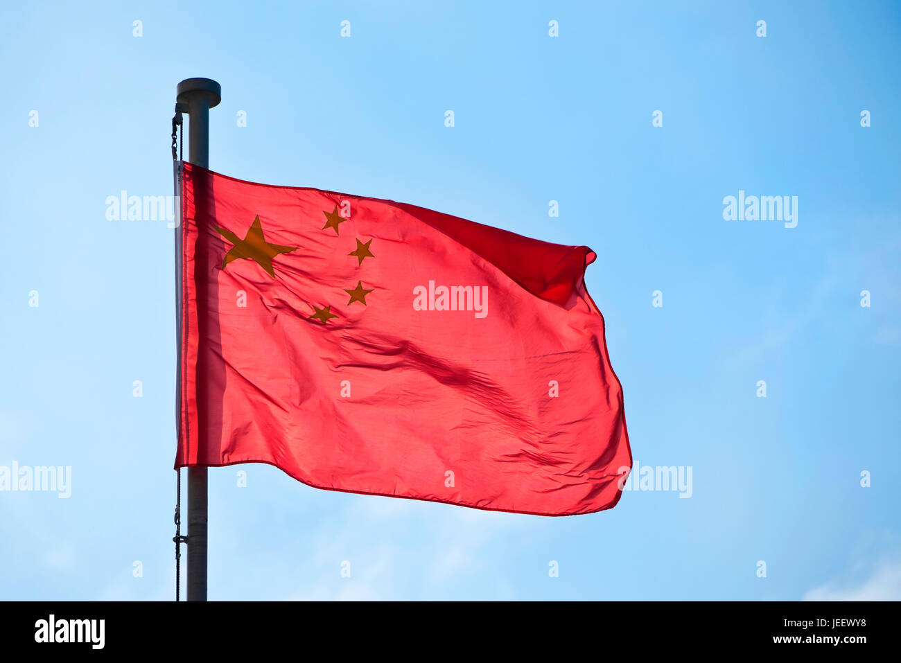 Horizontal close up view of the national flag of China. - Stock Image