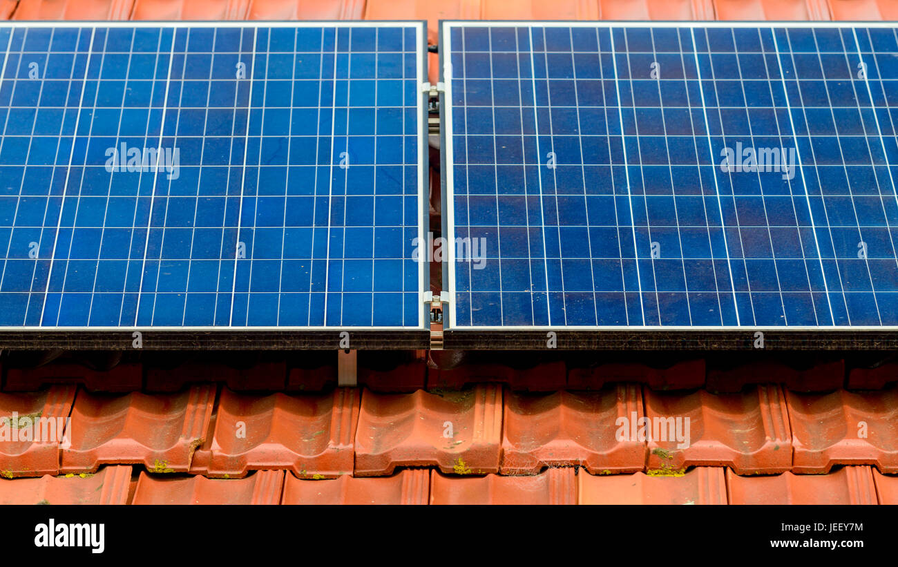 Dirty solar panels on the house roof inMelbourne suburbs, Victoria, Australia - Stock Image