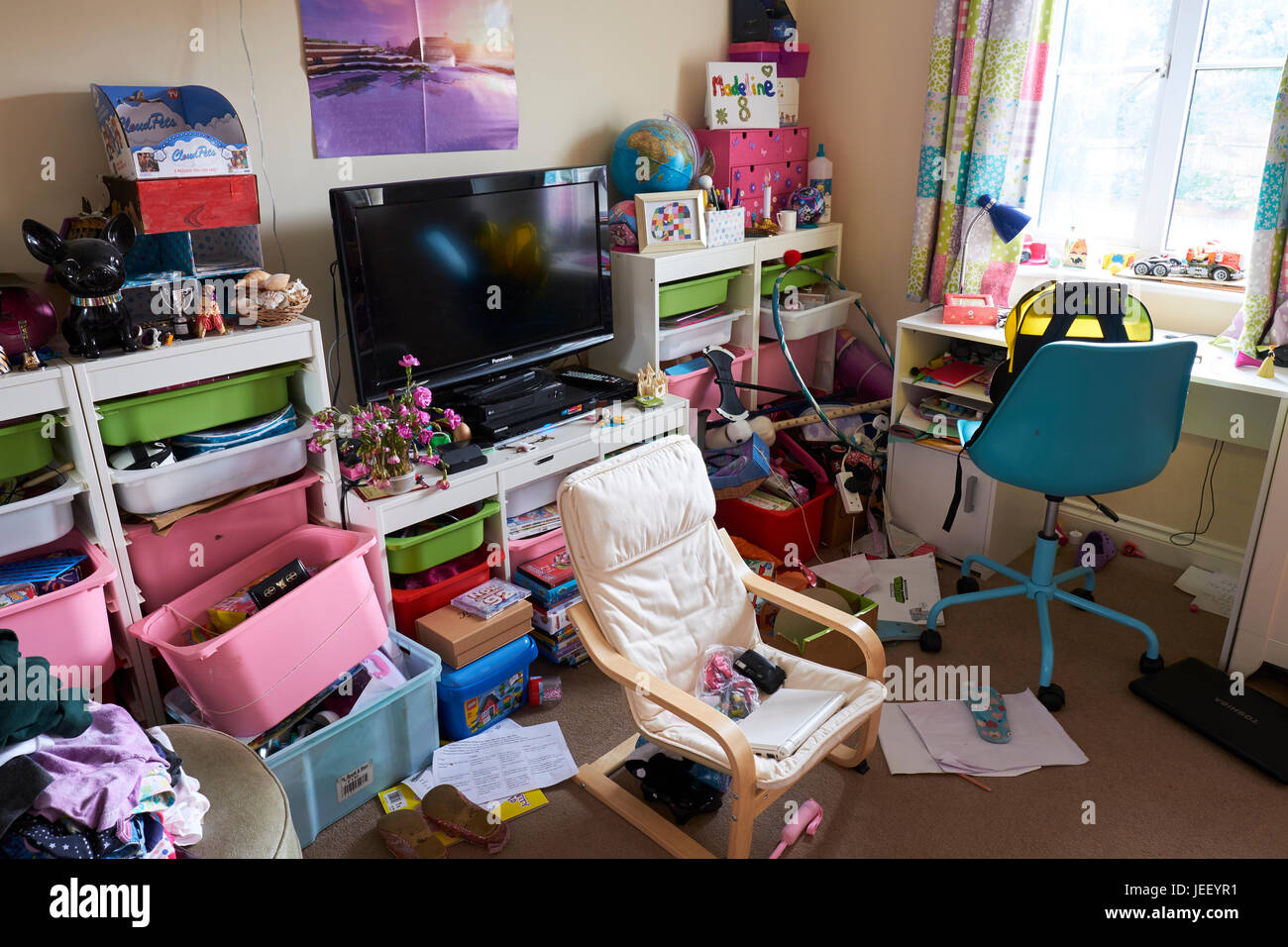 Young Girls Untidy Bedroom - Stock Image