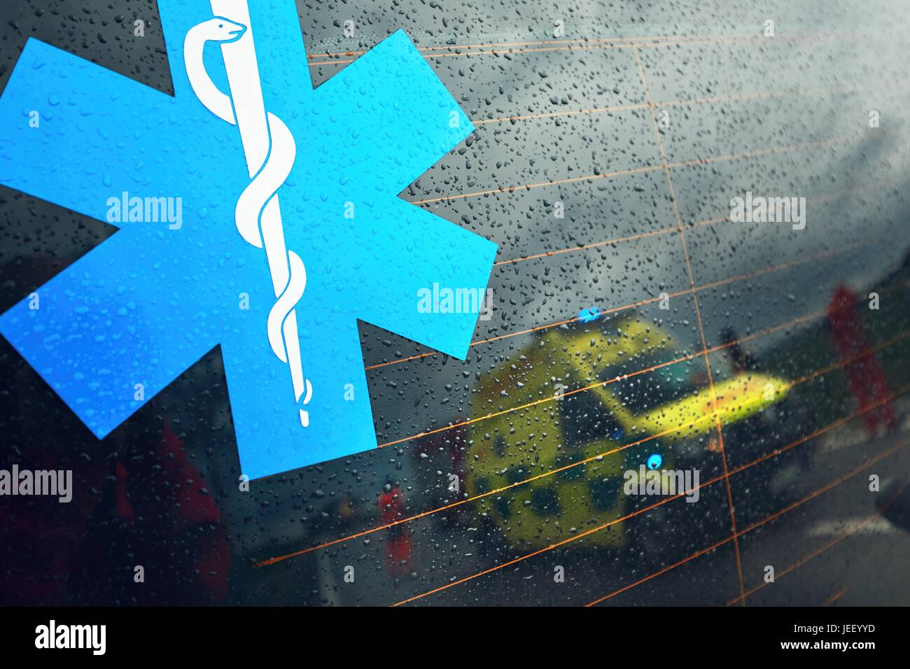 Reflection of the ambulance car. Teams of the Emergency medical service are responding to an traffic accident in - Stock Image