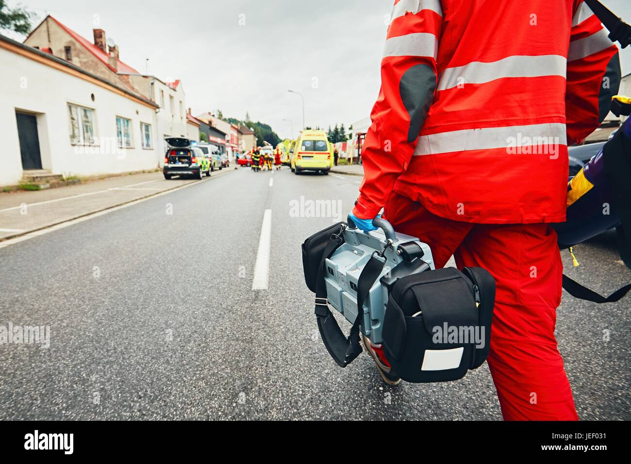Hand of the doctor with defibrillator. Teams of the Emergency medical service are responding to an traffic accident. Stock Photo