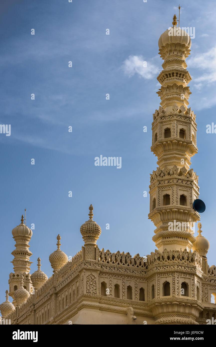 Mysore, India - October 26, 2013: Cream yellow minaret and part of upper structure of mosque at Tipu Sultan mausoleum - Stock Image