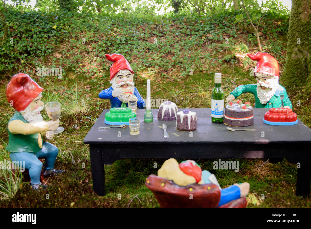 Gnomes Sat Around A Table Eating Cake And Drinking
