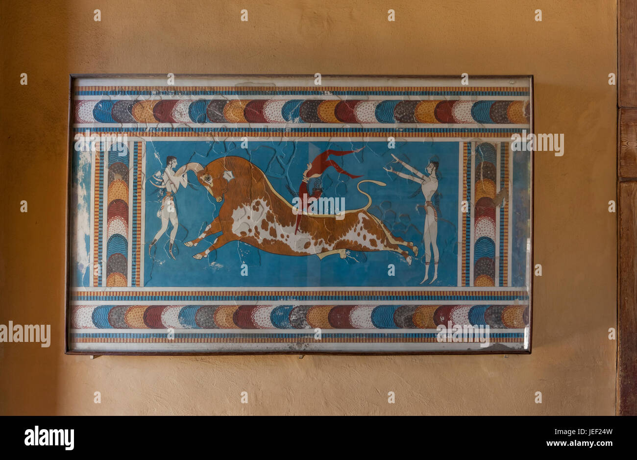 Bull-leaping fresco, Palace of Knossos, ancient city of Knossos, Heraklion, Crete, Greece - Stock Image