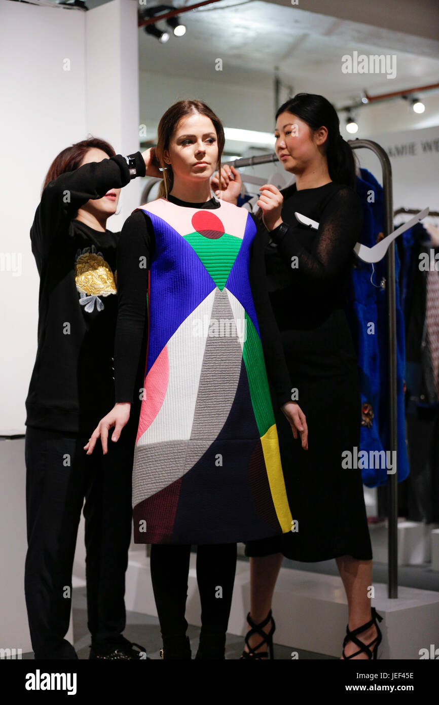 Moon Lee AW16 London Fashion Week Showrooms  presentation with a beautiful model wearing Moon Lee new collection - Stock Image