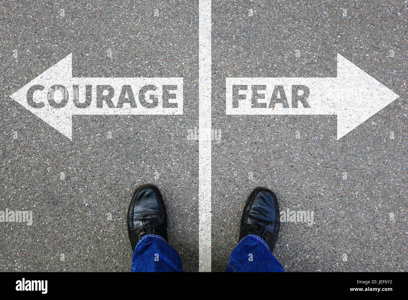 Courage and fear risk safety future strength strong business concept danger dangerous - Stock Image